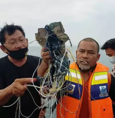 An Indonesian fisherman has recalled the moment he saw the Boeing 737 plane with 62 people onboard crash