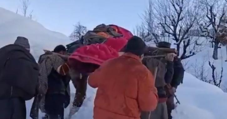 army carrying pregnant woman