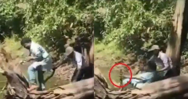 man catching snake