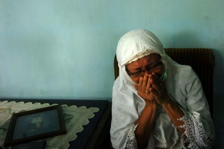 Sri Lungdiyanti, 41, family member of a Sriwijaya Air passenger reacts after the Flight SJ182 Boeing 737-500, crashed after taking off,