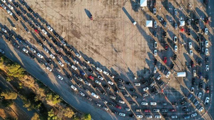 People line up in their vehicles at Dodger Stadium as post-Christmas COVID-19 testing resumes during a surge in positive coronavirus disease cases in Los Angeles