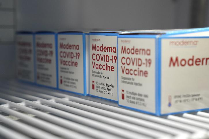 Boxes of Moderna COVID-19 vaccine are stored in a refrigerator at an ambulance company in Santa Fe Springs,
