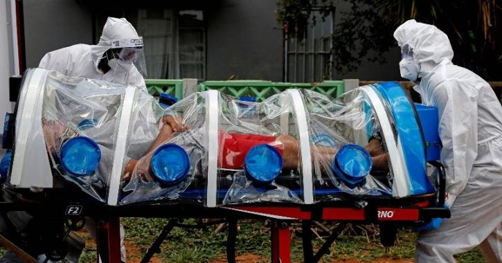 Paramedics prepare to transport a man showing symptoms of COVID-19 in Pretoria, South Africa, on Friday.