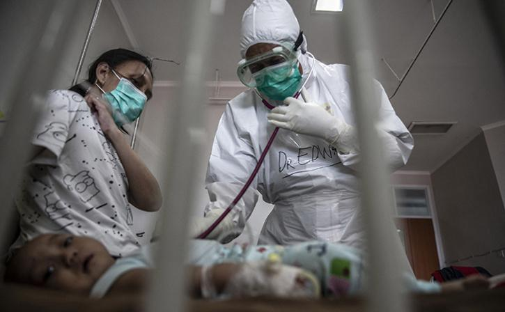 A doctor attends to a baby who tested positive for Covid-19 coronavirus at a hospital