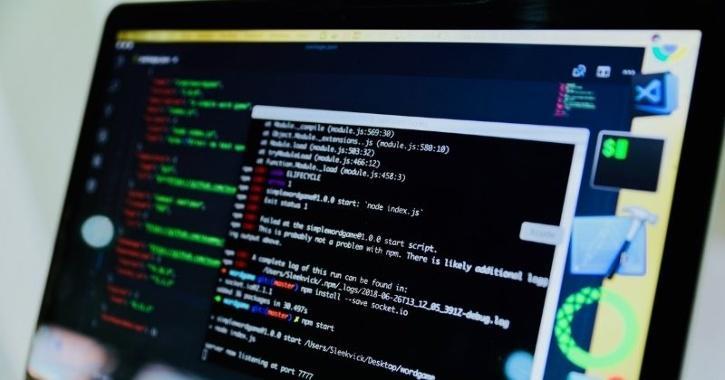 hacker executing code on laptop
