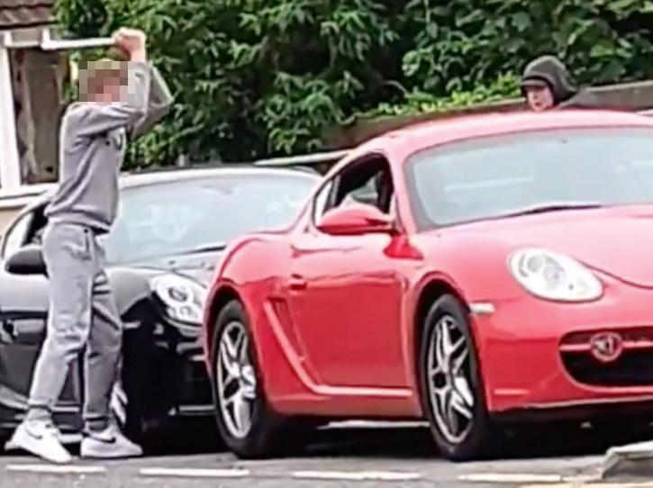 Youth smashes up Porsche in broad daylight
