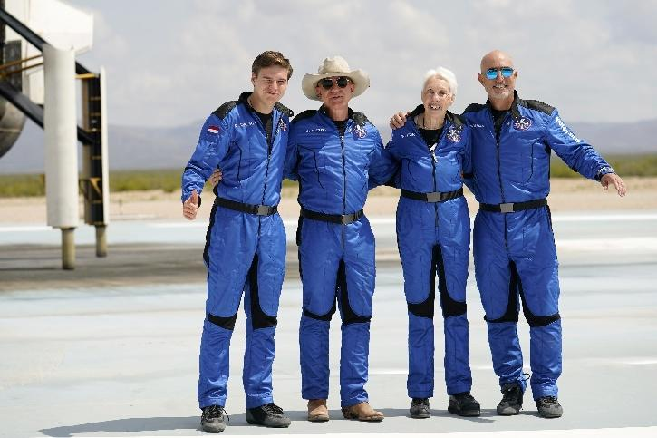 Oliver Daemen, from left, Jeff Bezos, founder of Amazon and space tourism company Blue Origin, Wally Funk and Bezos