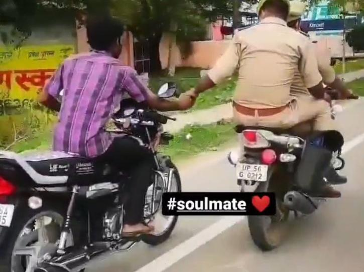 Cop Rides to Police Station While Holding Criminal's Hand