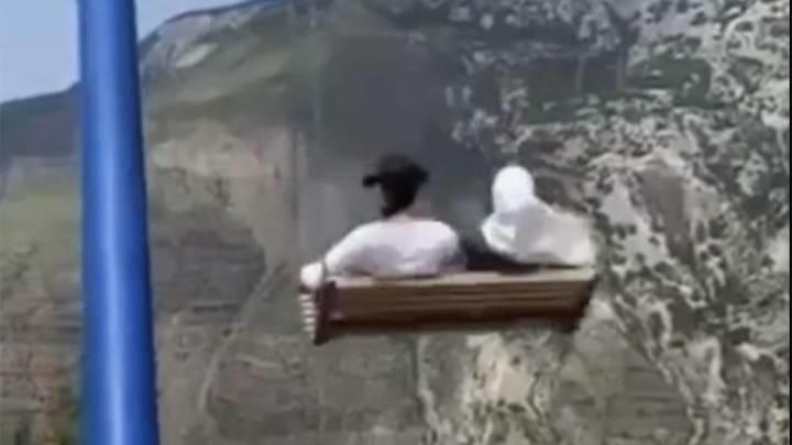 two women fall off swing on the edge of 6000-ft cliff