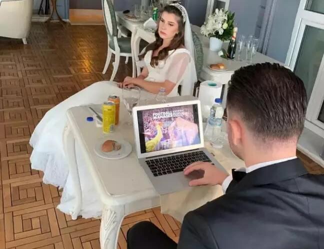 Groom plays vide game while bride waits