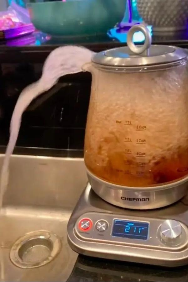 tea pouring out of the kettle