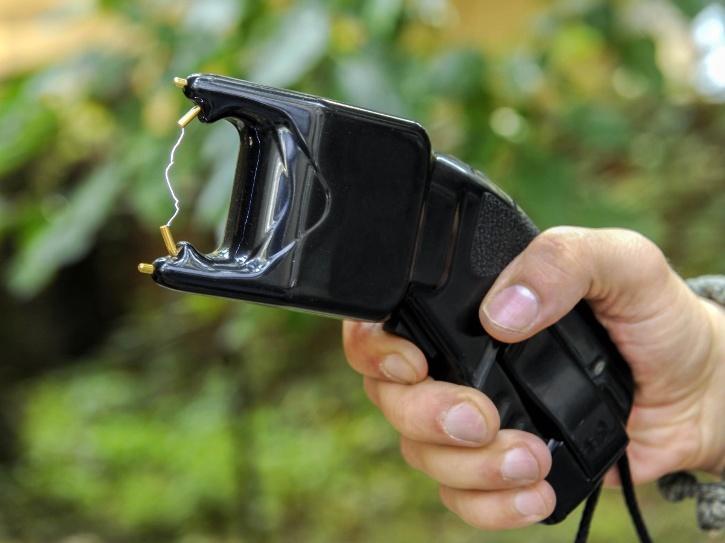 man using a stun gun
