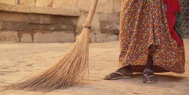 domestic worker sweeping