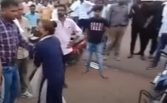 girl being escorted away