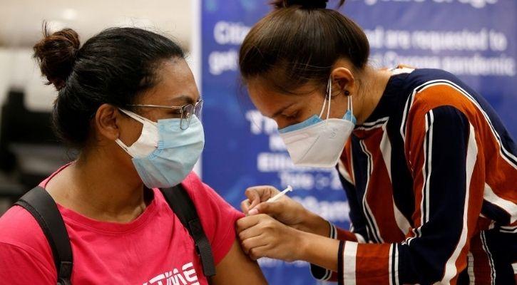 reliance jio whatsapp chatbot vaccine