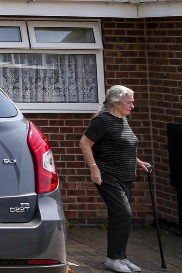 mrs lee walking in driveway