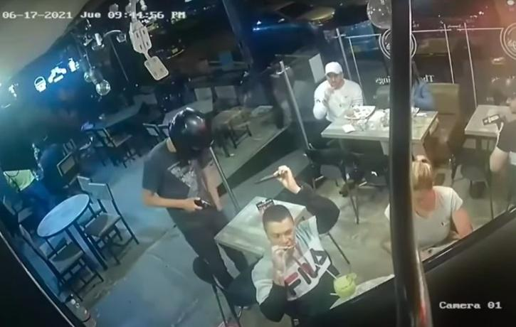man continues enjoying chicken wings while being robbed at gunpoint