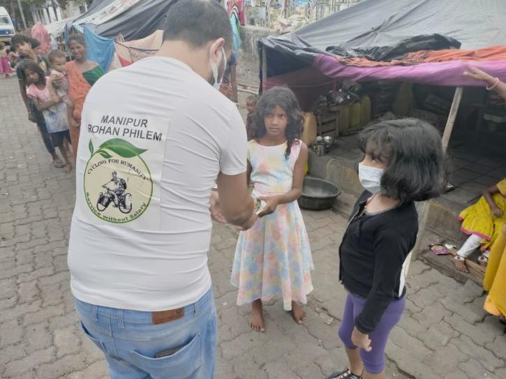 Volunteers helping people