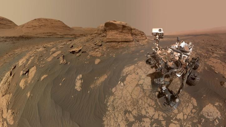 NASA's Curiosity Mars rover used two cameras to create this selfie in front of Mont Mercou