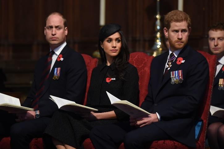 Prince William, Harry and Meghan Markle / Getty Images