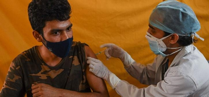 India vaccination class divide