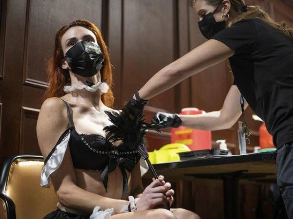 Even the dancers who work at the club got jabs while being dressed in their usual attire.