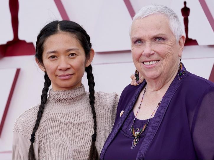Chloe Zhao with Swankie from Nomadland.