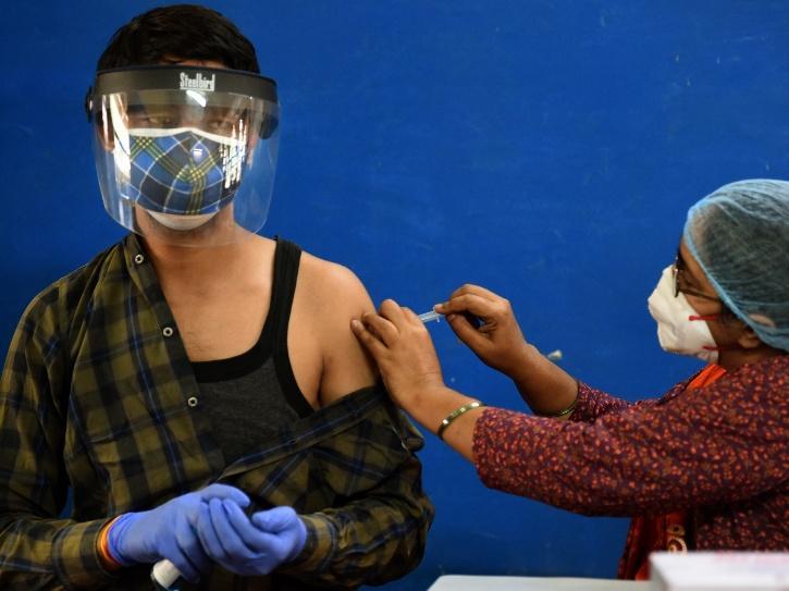 Man receiving Covid-19 vaccine