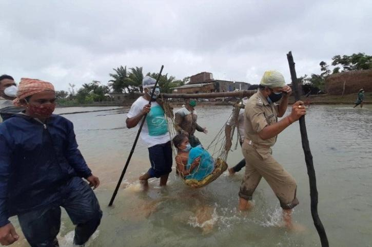 Cop rescues people during cyclone Yaas