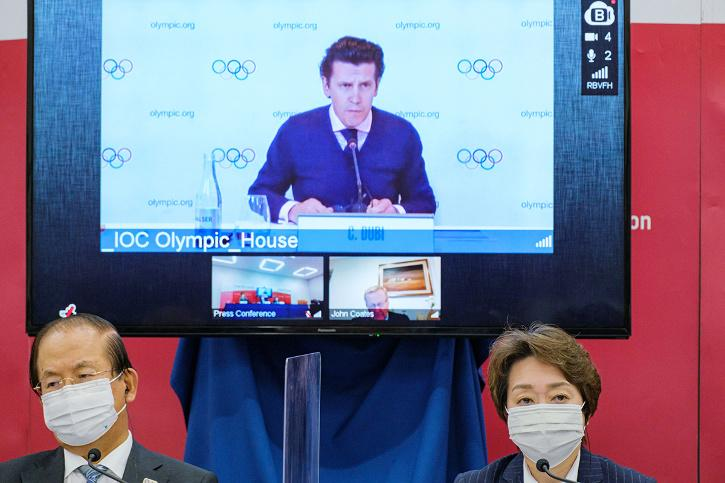 Tokyo 2020 President Seiko Hashimoto and IOC Games Executive Director Christophe Dubi remotely on-screen attend an International Olympic Committee (IOC)