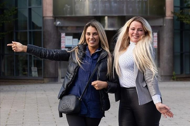 Kelsey Ridings and her friend Paige Azad celebrate outside Tameside Magistrates Court
