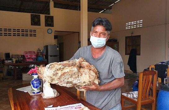 Narong Phetcharaj with the whale vomit he found