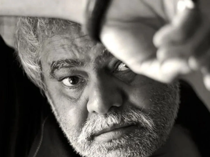 A black and white photo of Sanjay Mishra.