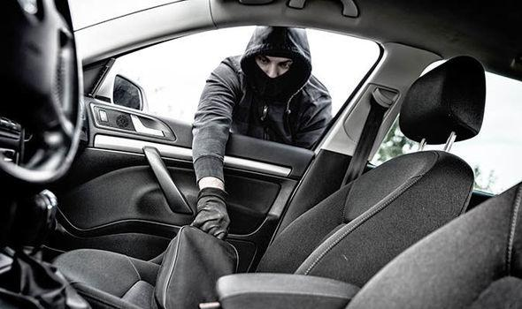 Thief stealing from car