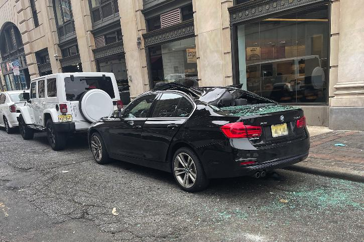 Man Survives Nine-Story Fall Into BMW