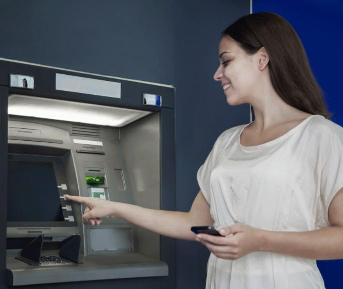 girl-taking-out-atm-machine