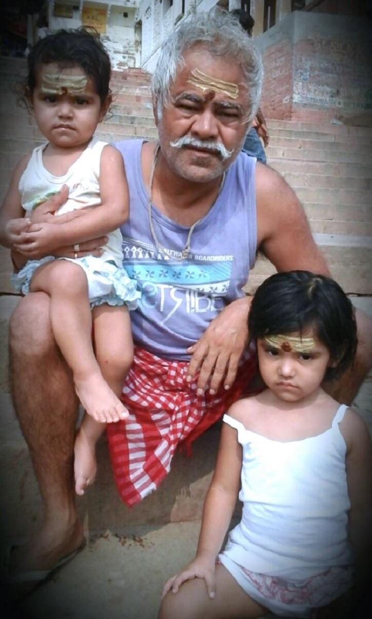 Sanjay Mishra with his daughters.