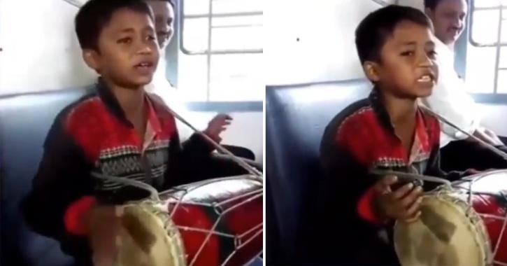Boy plays dholak and sings