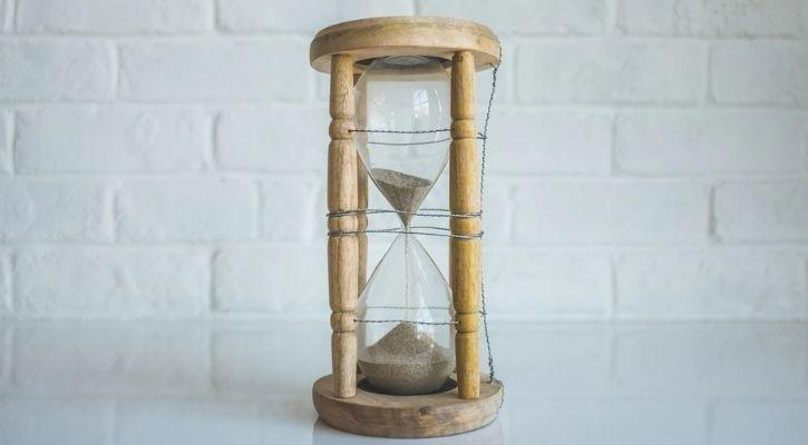 An hourglass is pictured in this image