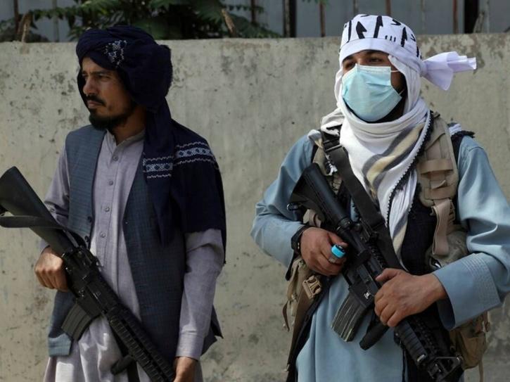taliban people with guns