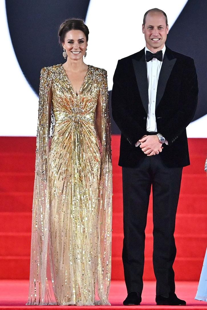 Bond Girl or the Duchess of Cambridge? Kate Middleton arrived at the No Time To Die world premiere with Prince William looking like a Golden Goddess. She even got a compliment from Daniel Craig.