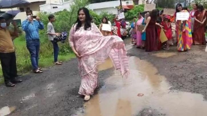 Women Catwalk Over Potholes To Draw Attention To The Poor Roads