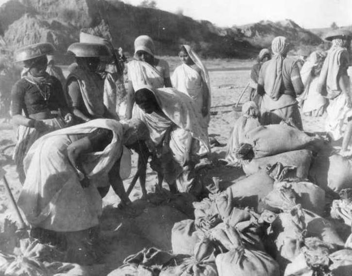 In Piture the brave Madhapar ladies helping to repair the runway, taken during the war.