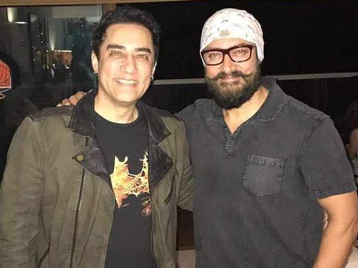 Faissal Khan and Aamir Khan smiling and posing for a photo together.