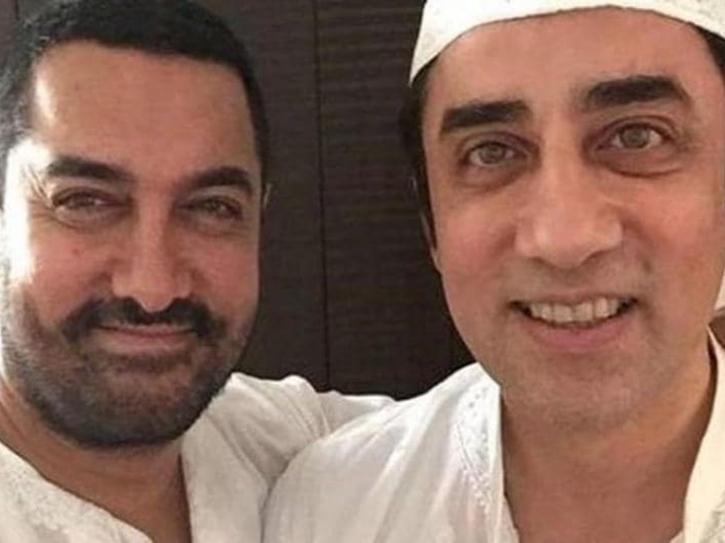 Aamir Khan and Faissal Khan smile with each other.