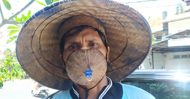 Photo of What An Idea! Indonesian Man Wears Coconut Shell As Mask Then Asked To Push Ups As Punishment   Sumedha Tripathi