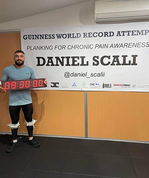 daniel scali standing with timer