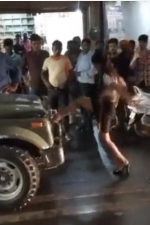 drunk-model kicks the army vehicle