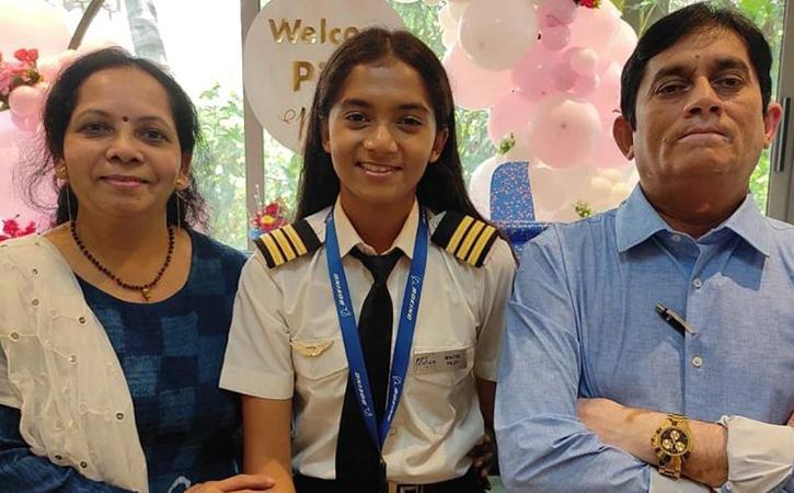 Maitri Patel with her parents