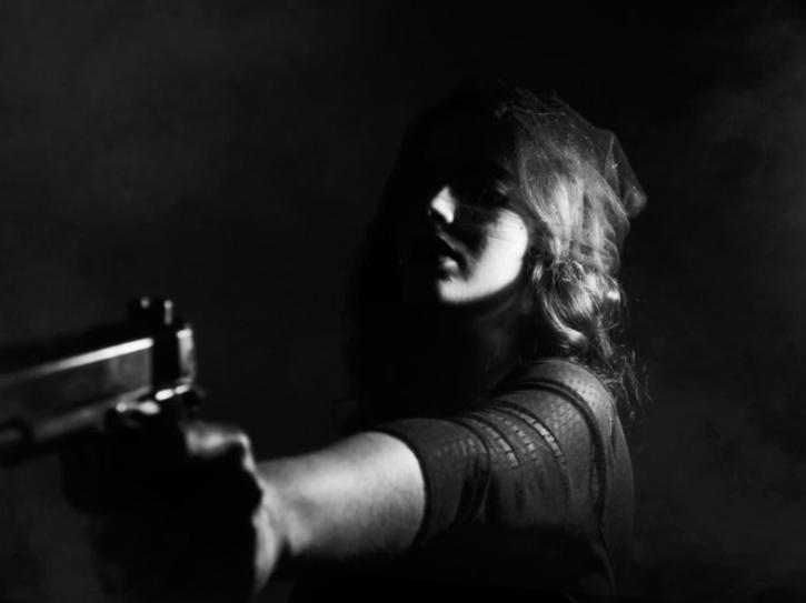 woman killing with a gun